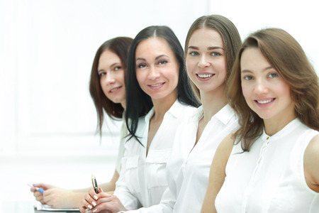 successful business team sitting at the Desk.photo with copy space