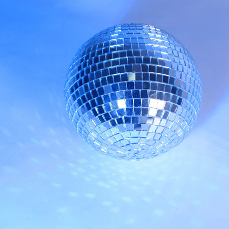 beautiful disco ball on yellow background isolated.