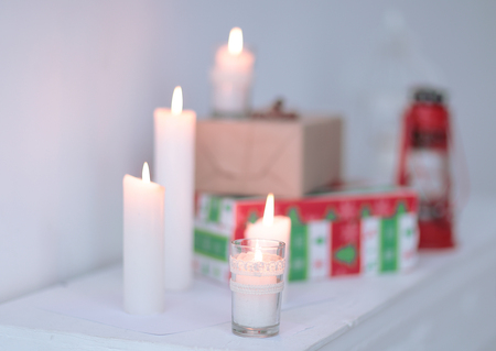 blurred image. candles and gift boxes .photo with copy space Banco de Imagens