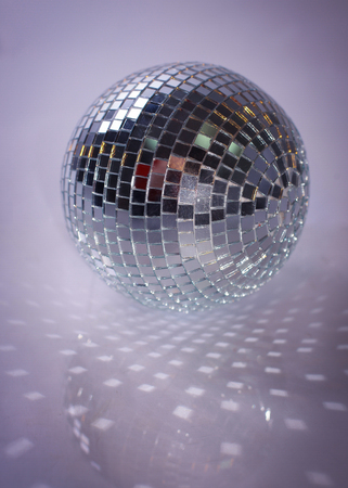 mirror ball.isolated on a dark background. photo with copy space