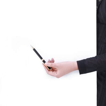 hand of business woman pointing with pen at a point on the blank screen Stock Photo