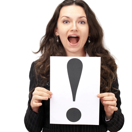 young business woman holding the exclamation mark