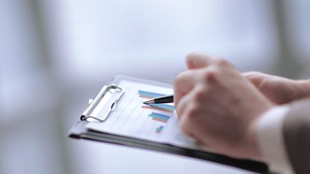 close up.businessman doing market analysis. business concept
