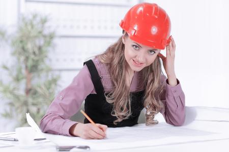 Business woman Drawing Blueprint At Office Desk 免版税图像