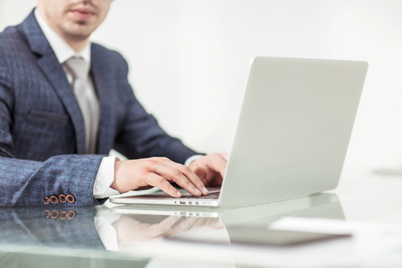 successful businessman working on laptop in the workplace. Stok Fotoğraf