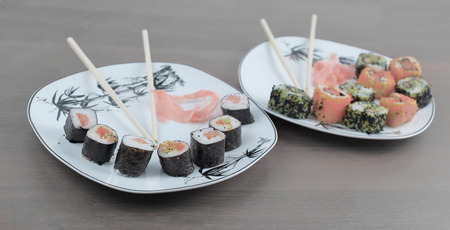 Roll of sushi prepared from raw fish and a special rice