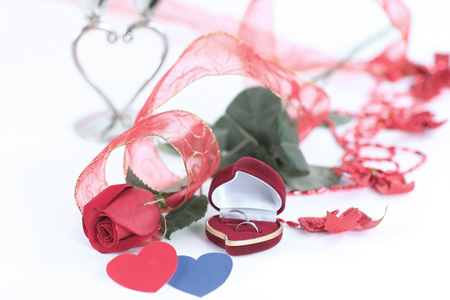 rose and a box with a ring on a Valentines day card .photo with Foto de archivo