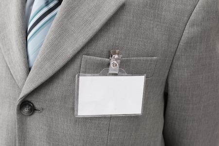 White blank name tag is attached to chest of a businessman . Stock Photo