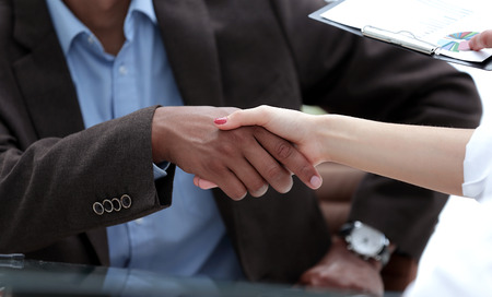 closeup. handshake financial partners . the business concept.