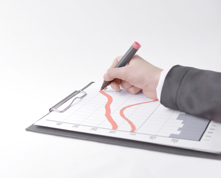 closeup .Businessman drawing a stock chart.isolated on white