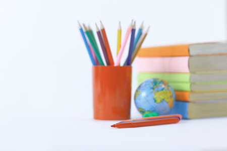globe, books and pencils on white background .photo with copy sp Banco de Imagens