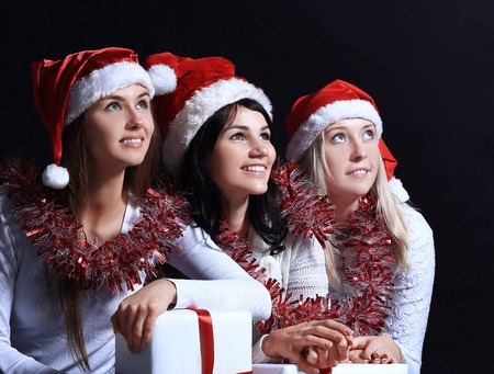 group of happy women in costumes of Santa Claus and Christmas sh 免版税图像