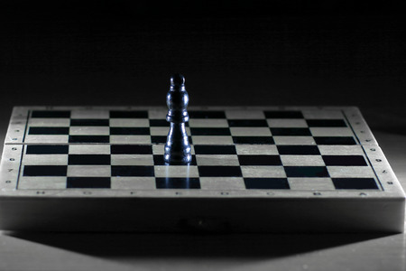 black king on a chessboard . photo with copy space 免版税图像 - 112949683