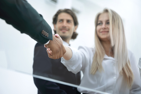 young business woman shaking hands with the investor.