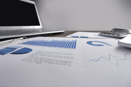 business background. financial report and laptop, on business D Banco de Imagens
