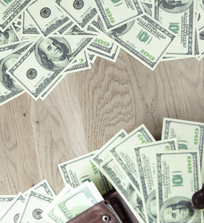 close up. frame of dollar bills on wooden background