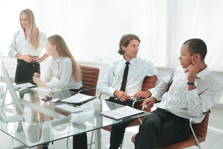 woman presenting her idea to colleagues at meeting