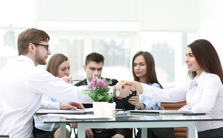 handshake of business partners on a Desk in the office