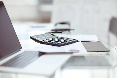 close up. laptop and calculator on the Desk in the office