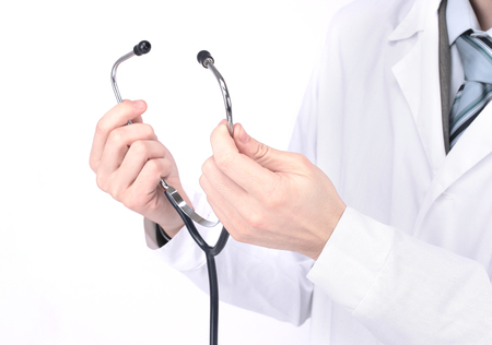 closeup. medical practitioner holding a stethoscope. isolated on a white background