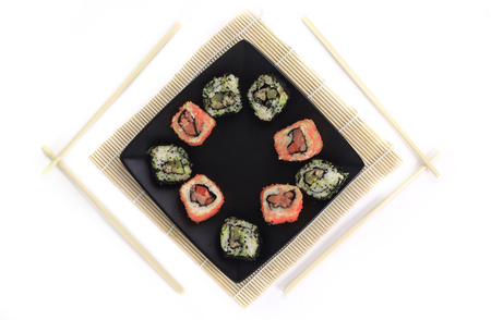 different types of Maki sushi on a black plate 免版税图像