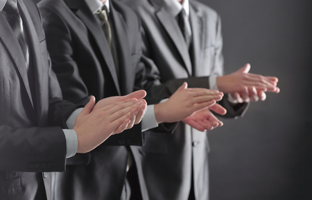 close up.a group of business people applauding standin Stock Photo