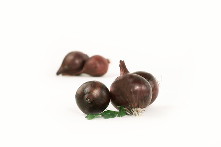 several heads of the red onion.isolated on a whit Stock fotó