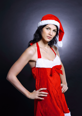 closeup. beautiful young woman in costume of Santa Claus.