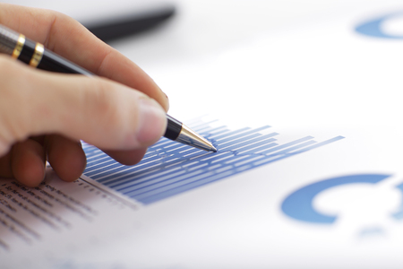 close up.businessman making a financial report. business concept