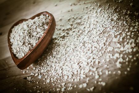 closeup.oat bran cereal on a wooden table. Standard-Bild - 113926306