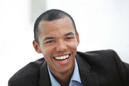 closeup.portrait of a young businessman on a light background