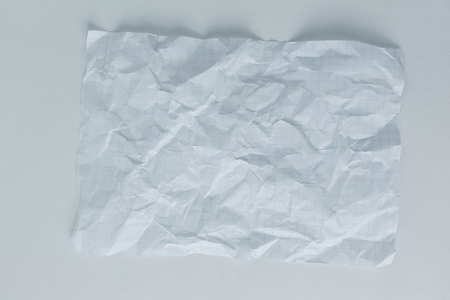 crumpled notebook sheet on white background.photo with copy space