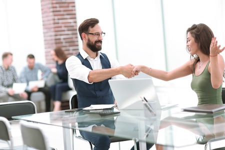 business handshake of a businessman and businesswoman