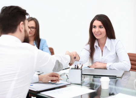 business woman is shaking hands with an employee at a work meeting Stock Photo