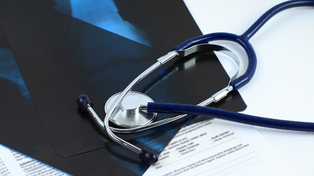 stethoscope and x-rays on a white background