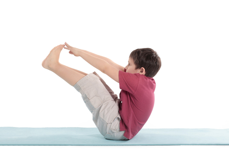 little boy performs morning health gymnastics.isolated on white
