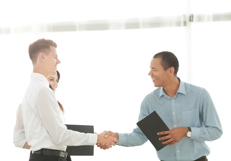 handshake of business people standing in office