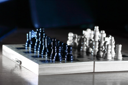chess composition on dark background. strategy concept