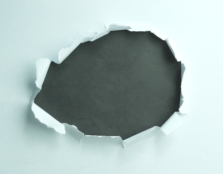 paper with torn middle for advertising text with gray background 写真素材