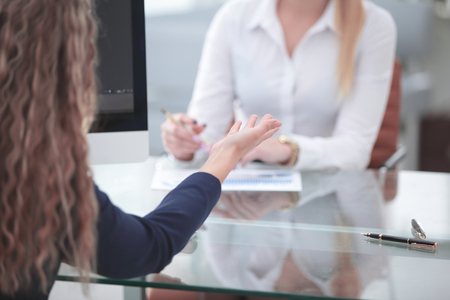 close up. two business women talking at the Desk