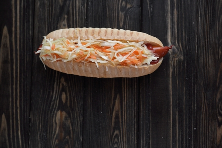 hot dog with vegetables on wooden background.photo with copy space Stock Photo