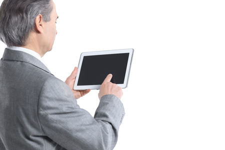 close up.the businessman points to the tablet screen.rear view.isolated on white background