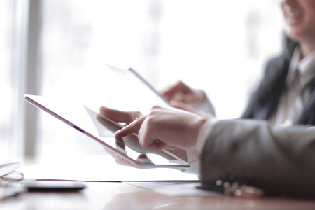 businessman clicks on the screen of a digital tablet Stock Photo