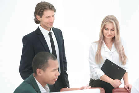 closeup .employees look at the handshake business partners Фото со стока