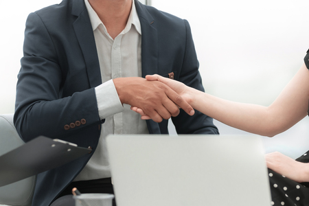 close up.business handshake business partners in the office Фото со стока
