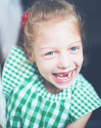 portrait of smiling cute little girl in the nursery.