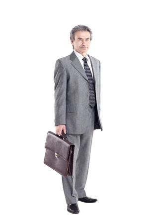in full growth. Executive businessman with leather briefcase.isolated on white background