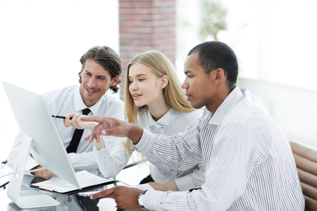 business team discussing information from the Internet