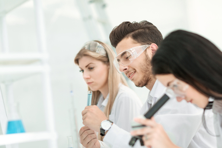 close up.a group of young scientists conduct experiments in the laboratory.