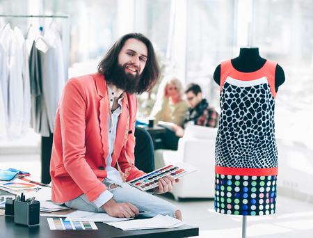 portrait of a fashion designer in a creative office